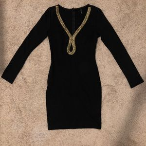 Black bandage dress with gold trimming